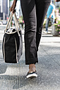 Woman with shopping bag, partial view - GIOF02542