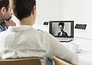 Business people having a video conference in office - UUF10275