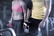 Man and woman in gym having a break - ZEF13321