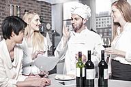 Chef with three women in kitchen - ZEF13372