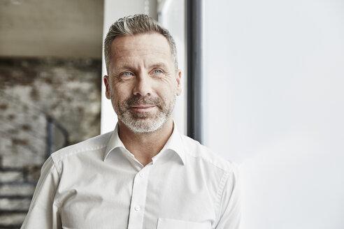Portrait of confident businessman - FMKF03676