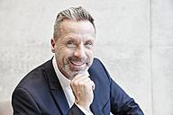 Portrait of smiling businesssman - FMKF03727