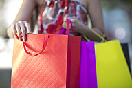 Close-up of woman holding shopping bags - ZEF13384