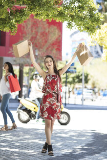 Happy young woman with shopping bags - ZEF13405