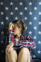 Young woman in front of star-shaped background - KKAF00619