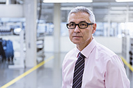 Portrait of a manager on shop floor of a factory - DIGF01652