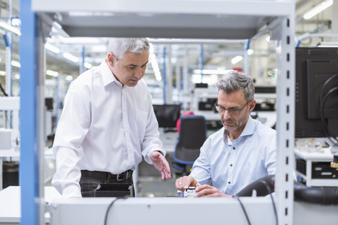 Two managers discussing product in company - DIGF01679