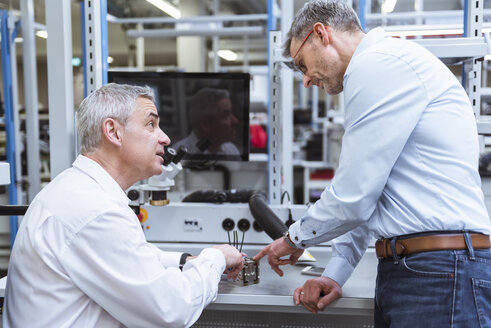 Two managers discussing product in company - DIGF01688