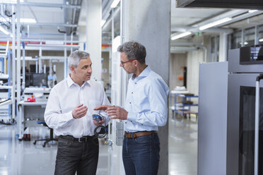 Two managers in company, discussing new product - DIGF01694