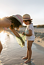 Spain, Menorca, two girls with dip net on the beach - MGOF03167