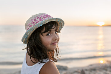 Spain, Menorca, portrait of girl on the beach at sunset - MGOF03176