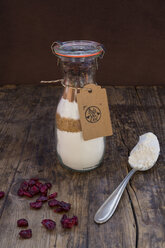 Glass bottle with ingredients of baking mix for cranberry chocolate cake - LVF05975