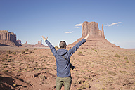 USA, Utah, back view of man with raised arms looking at Monument Valley - EPF00418