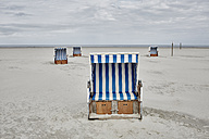 Germany, Schleswig-Holstein, St Peter-Ording, hooded beach chair - RORF00710