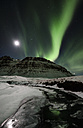 Iceland, Northen lights in the mountain - RAEF01786