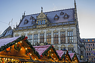 Germany, Bremen, view to Schuetting with Christmas market stands in the foreground - PVCF01059