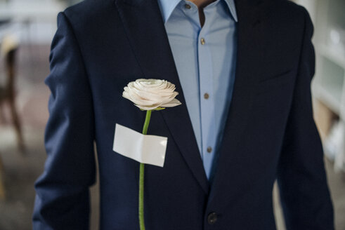 Close-up of businessman with rose attached to his jacket - KNSF01208