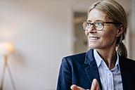 Portrait of confident businesswoman wearing glasses - JOSF00718