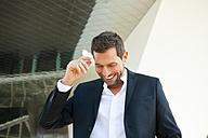 Confident businessman outdoors - CHAF01847