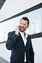 Portrait of confident businessman outdoors - CHAF01862