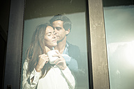 Young couple in love at the window - SIPF01529