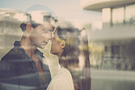 Young couple in love behind windowpane - SIPF01532
