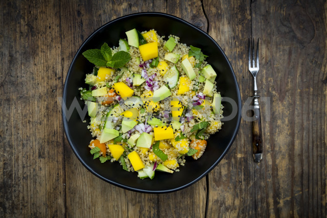 Bowl of quinoa salad with mango, avocado, tomatoes, cucumber, herbs and black sesame - LVF05987