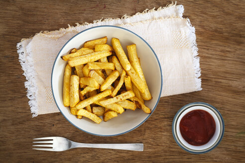 Bowl of swede fries and bowl of ketchup - EVGF03194