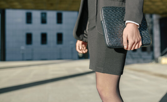 Businesswoman carrying briefcase, mid section - DAPF00627