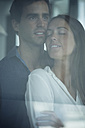 Young couple in love behind windowpane - SIPF01574