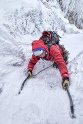 Scotland, Anoach Mor, Man ice climbing in winter - ALRF00898