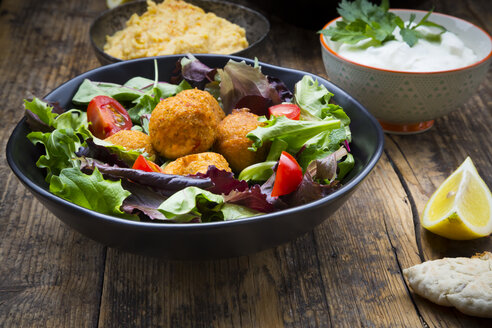 Bowl of mixed salad, tomatoes, sweet patato Falafel and Hummus, yoghurt sauce and flat bread - LVF06009