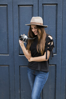 Young woman with camera - KKAF00641