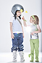 Girl dressed up as alien getting in contact with boy dressed up as spaceman - FSF00820
