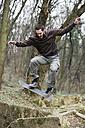 Skateboarder doing a trick - MOMF00050