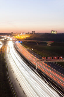 Germany, Baden-Wuerttemberg, Autobahn A8 near Stuttgart at twilight - WDF03991