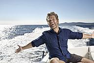 Portrait of happy mature man on his motor yacht - PDF01093