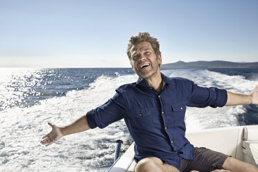 Portrait of happy mature man on his motor yacht - PDF01093