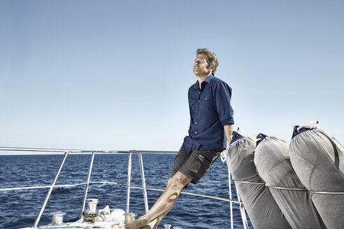 Mature man on his motor yacht - PDF01114