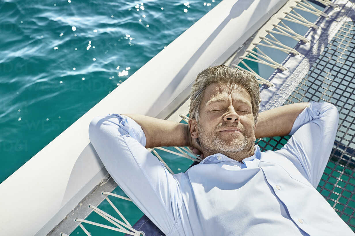 Portrait of mature man relaxing on  his motor yacht - PDF01132 - Philipp Dimitri/Westend61