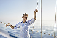 Portrait of mature man on his sailing boat - PDF01162