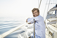 Portrait of smiling mature man on his sailing boat - PDF01165