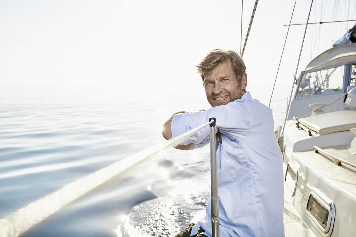 Portrait of smiling mature man on his sailing boat - PDF01165 - Philipp Dimitri/Westend61