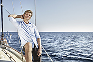 Portrait of smiling mature man on his sailing boat - PDF01186