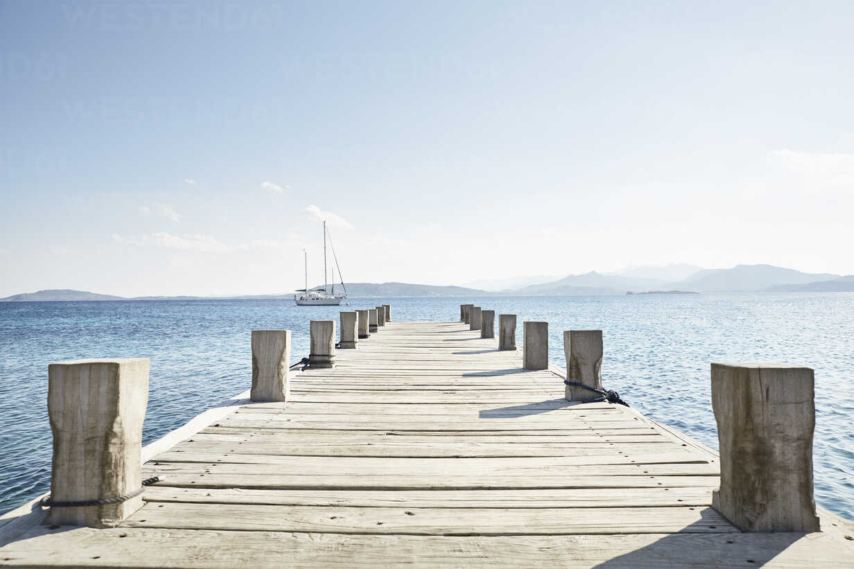 Empty jetty and saling boat in the background - PDF01210 - Philipp Dimitri/Westend61