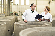 Chemists in concrete factory doing a quality check - JASF01588