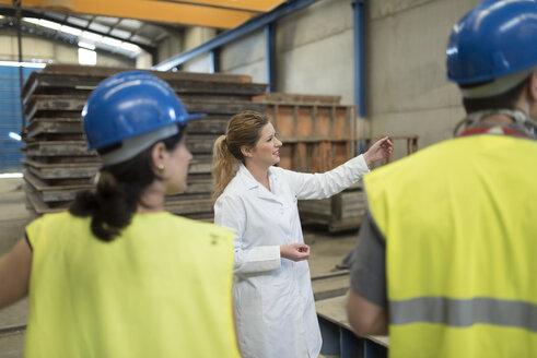 Scientist briefing workers in factory - JASF01606