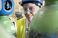 Woman working a factory, portrait - JASF01657