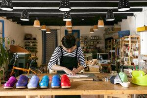 Clogmaker working in her workshop - VABF01301