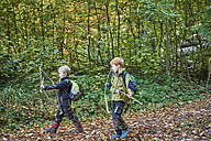 Two little boys with self-made bows and arrows in autumn - JEDF00294